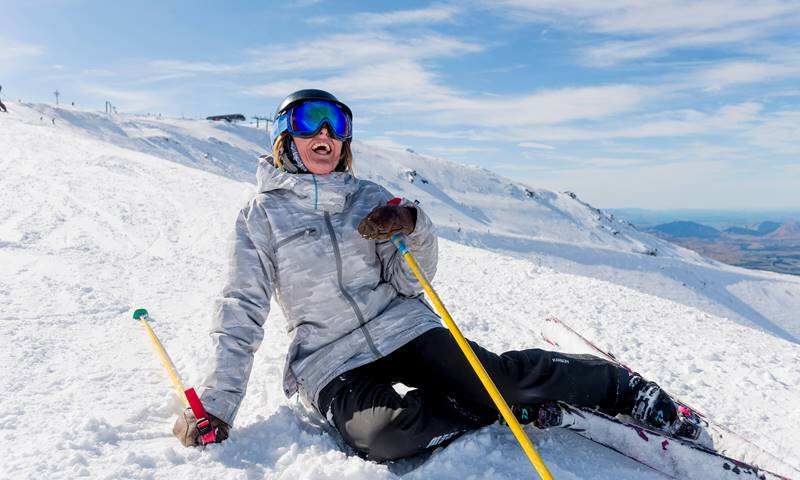 Mt Hutt Skier Resting On Snow Laughing