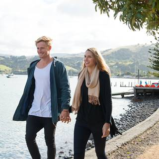 Couple Walking Along the Waterfront at Akaroa