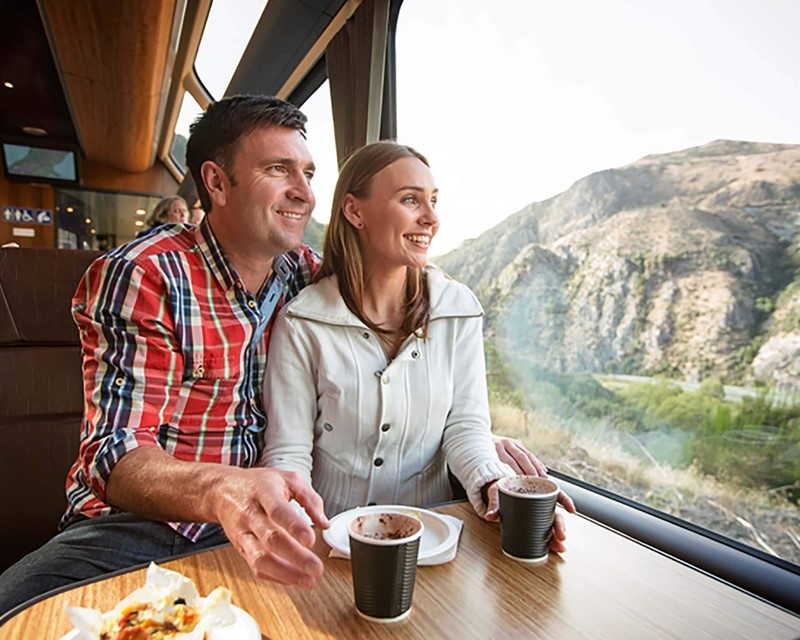 Kiwirail Great Journeys of New Zealand Couple on Train